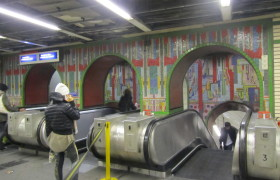 Arches over escalators at Tottenham Court Road tube