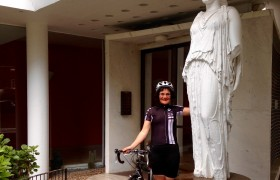 Elain Harwood in cycling kit at the entrance of Highpoint